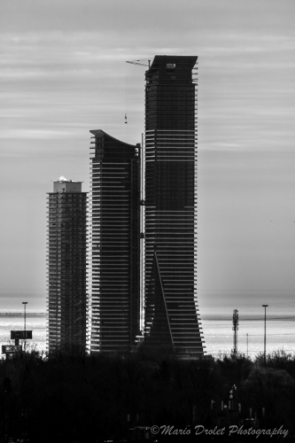Black and white photo condo towers under construction