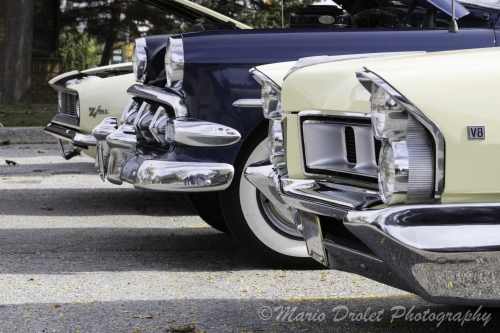 Quarter view of 3 cars' front end in colour
