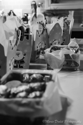 Black and white photo of baked goods Christmas boxes