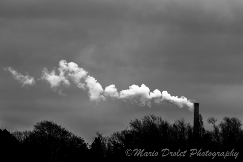 Black and white photo of a smoke stack